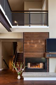 architecture two way gas fireplace and beige wall and wood screen