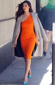 orange dress aldridge swaps skintight leather trousers for slinky orange