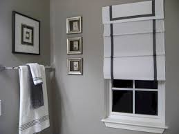 bathroom engaging white fabric shade window with artwork portray