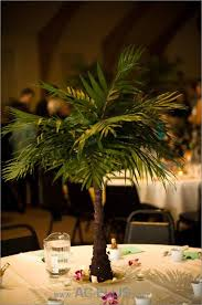 mini palm tree centerpiece great for a themed wedding or