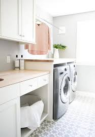 White Laundry Room Cabinets White Laundry Room Cabinets With Butcher Block Countertops