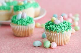 Decorating Easter Egg Cupcakes by 35 Adorable Easter Cupcake Ideas