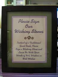 wedding wishing stones instead of a guest book friends and family sign a wishing