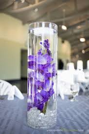 table center pieces lantern and purple candle wedding table centerpiece purple