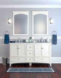 furniture beadboard pattern white wood medicine cabinet over metal