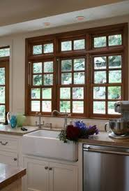 white kitchen cabinets with window trim would these windows in the kitchen wood trim white