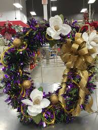 large lighted mardi gras wreath on my florals store