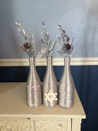 silver wine bottles metallic silver christmas wine bottle centerpiece that spells