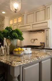 antique ivory kitchen cabinets with black brown granite