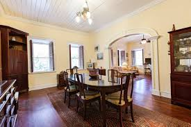 dining room with yellow wall colors and mahogany furniture pieces