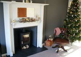 charnwood c four on log with honed granite hearth and slips painted arts and craft surround hearth too dark in black