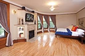 contemporary guest bedroom with crown molding ceiling fan in