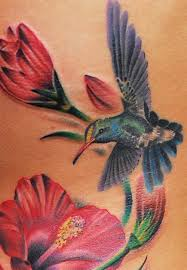 Hummingbird On A Flower - 25 stunning watercolor hummingbird tattoo meaning and designs