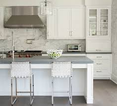 marble tile backsplash kitchen kitchen subway tile from floor to ceiling and doorway with