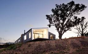 striking prefabricated home settles into this stunning rural site