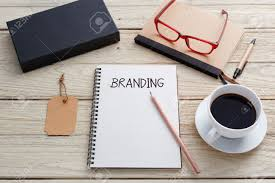 branding concept with notebook brand tag product box glasses