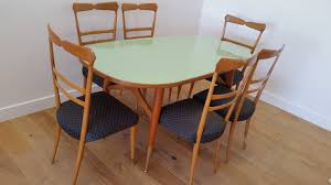 ico and luisa parisi dining table and six chairs c 1950 italy