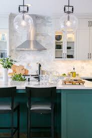 green kitchen cabinets with white island the best in green kitchen trends town country living