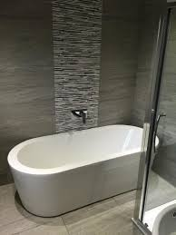 scintillating cave bathroom pictures ideas orchard wharfe freestanding bath grey tiles freestanding bath