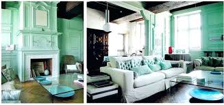 blue and green home decor example of a trendy living room library