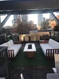 my new ish rooftop patio with outdoor kitchen malelivingspace
