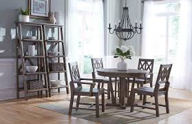rustic round weathered gray dining table with extension leaf by