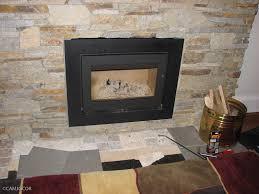furniture ideas multi colored brick fireplce with metal black