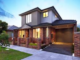red brick house color schemes red brick exterior house color scheme with electric roller shutter