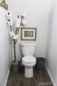 rustic bathroom branch toilet paper holder the summery umbrella