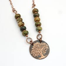 rhyolite tree necklace with green and white etched copper
