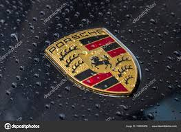 Porsche Logo Close Up On A Black Car With Rain Drops U2013 Stock