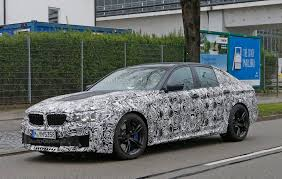 2018 bmw m5 spied sporting new headlights and tail lights