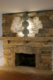 41 best fireplace indoor images on pinterest fireplace ideas indoor stone fireplace with a double helix design element pictured here with tealight candles