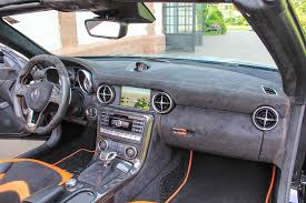 mercedes slk 55 amg gets carlsson interior with orange and carbon