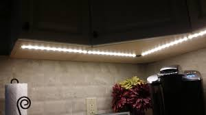 under cabinet light with outlet portfolio flat river electric
