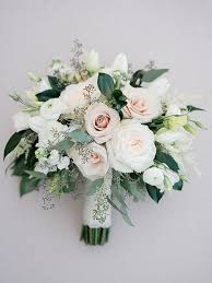 wedding bouquet white ranunculus and eucalyptus bouquet dragonfly events