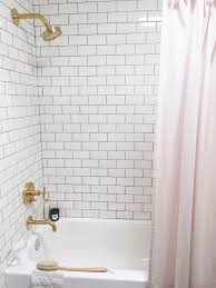 white subway tile and blush pink shower curtain bathroom design