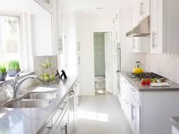 white galley kitchen design with glossy light grey quartz