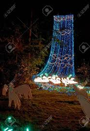 what do christmas lights represent this outdoor nature scene at night is a cascade of blue and green