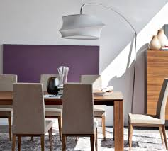 lighting purple wall and arc floor lamp plus wooden dining table