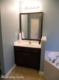 Framing Bathroom Mirrors Diy - decorating cents framing the bathroom mirrors