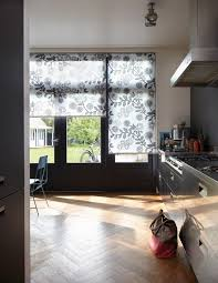 flora and fauna designs in this luxaflex kitchen roller blind in