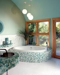 bluish green gives a serene vibe to the spa styled master bath