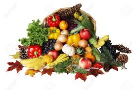 thanksgiving basket filled with autumn fruits and vegetables stock
