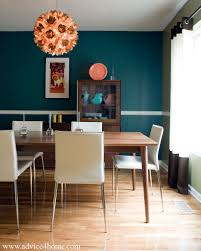 wall and brown dining table design in dining room