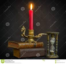 magic books hourglass and candle stock photos image 34181143