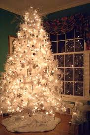 white tree led lights with happy holidays and 8 02 on