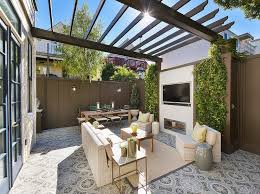 backyard with gray pergola and gray privacy fence transitional