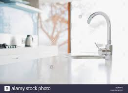 close up of modern kitchen faucet and sink stock photo royalty