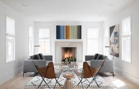 white living room with abstract wall arts and center fireplace